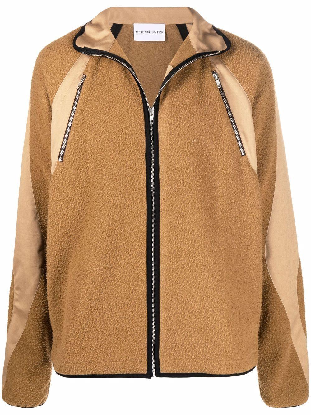 <p class='small-title'>ARNAR MAR JONSSON</p>Windbreaker Jacket